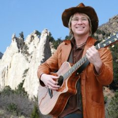 """JOHN DENVER inducted into the Colorado Music Hall of Fame, hosted by Olivia Newton-John, as Governor Hickenlooper declares """"Earth Day in Space."""""""